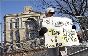 Elva Einsel protests outside of the Seneca County Courthouse. Ms. Einsel, who is 83, has lived in Tiffin for 21 years and was part of a group of supporters who voiced their anger at the county's decision to demolish the building.