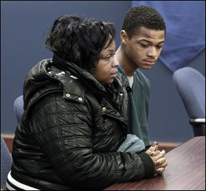 Davion Wilson sits next to his mother, Martina Wilson, during his hearing in Lucas County Juvenile Court. Young Wilson is charged in the shooting death of 17-year-old Deadrick Rocker on Friday.