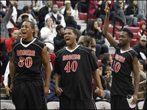 Rogers' from left: Darrin Tucker, Talon Floyd, and Kenny Walker, celebrate their win against Bowsher.