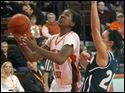 BGSU's Alexis Rogers twists around Akron's Taylor Ruper. Rogers scored 26 points and had 14 rebounds Saturday.