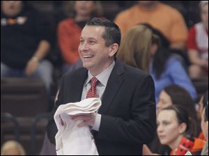BGSU Falcons coach Curt Miller smiles at his players on the court prior o the game against the Akron Zips at the Stroh Center.