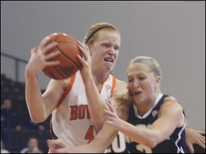 Danielle Havel of Bowling Green protects the ball after getting an offensive rebounds against Akron's Kacie Cassell.
