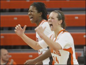 Falcons Alexis Rogers, left, and Jessica Slagle cheer when Akron calls a timeout after BGSU's Allison Papenfuss' lay-up tied the game in the second half.
