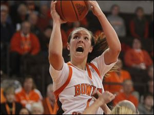 BG's Jessica Slagle gets some air and shoots to score two of her 14 points of the game.