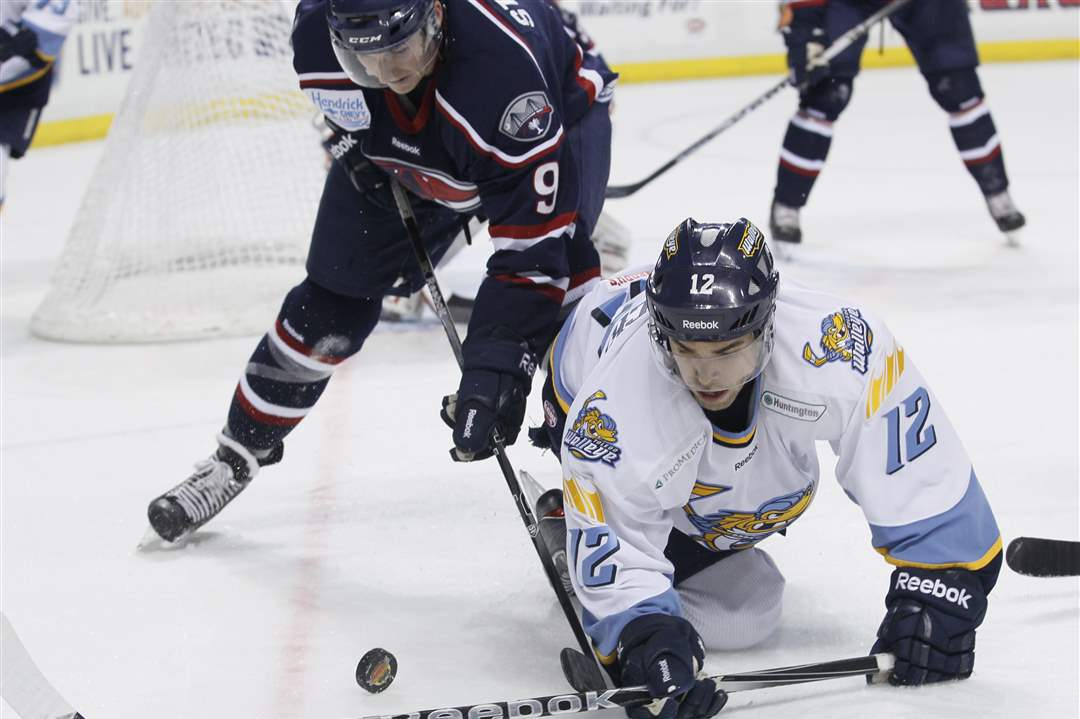 South-Carolina-Dustin-Stevenson-knocks-Toledo-Aaron-Lewicki-to-ice