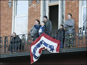 Spectators on a balcony overlooking South Washington Street in Tiffin, Ohio, watch the demolition of the Seneca County Courthouse.