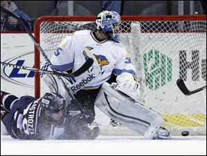 Walleye goalie Rob Nolan (35) watches the puck hit the back of the net as a sliding David