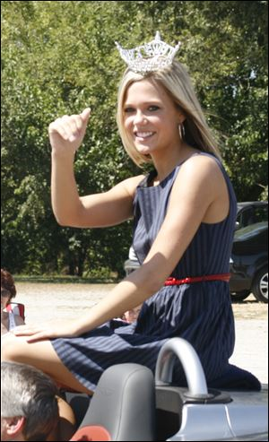 Miss Monroe County Elizabeth Wertenberger waves during a parade.