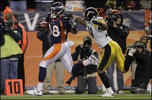 Denver's Demaryius Thomas breaks away from Pittsburgh defensive back Ryan Mundy for the winning touchdown in overtime. The 80-yard score came on the first offensive play of overtime.