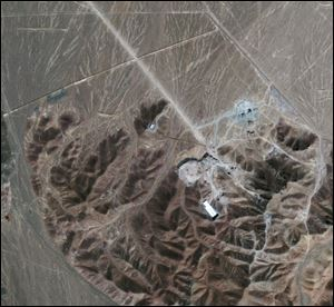 In this Sept. 26, 2009 file satellite image provided by GeoEye shows a facility under construction inside a mountain located about 20 miles (32 kilometers) north northeast of Qom, Iran. Iran has begun uranium enrichment at a new underground site well protected from possible airstrikes, a leading hardline newspaper reported Sunday, Jan. 8, 2011.
