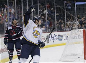 Walleye rookie Joey Martin raises his fist after scoring a goal against the Stingrays in the first period.