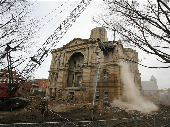 Courthouse sw corner demo A wrecking ball knocks out the upper southwest corner of the Seneca County courthouse Monday afternoon.