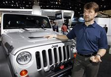 Jeep-CEO-and-President-Mike-Manley-speaks-next-to-a-Jeep-Wrangler