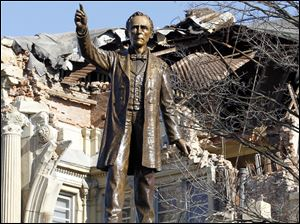 Demolition continues behind a statue of William Harvey Gibson, a Civil War general and Ohio native.