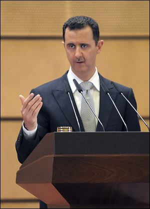 Syrian President Bashar Assad delivers a speech at Damascus University, Syria.