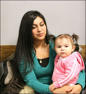 Angela Rios, a nursing student and single mother of 1-year-old Alina, is representative of a new group, those in 'situational poverty' because of circumstances such as job loss.