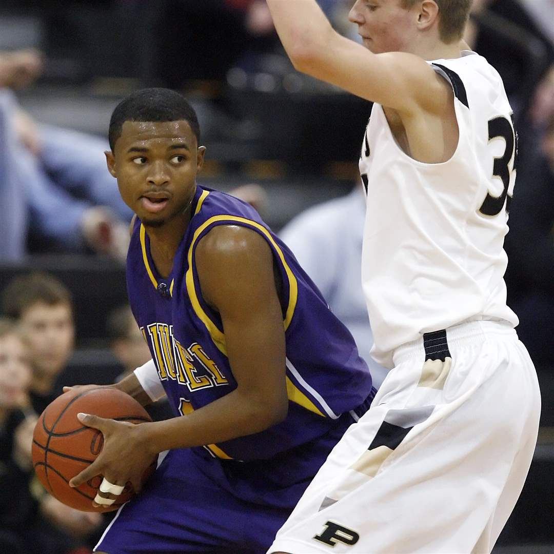 Maumee-s-Dominique-King-tries-to-get-past-Perrysburg-s-Shane-Edwards