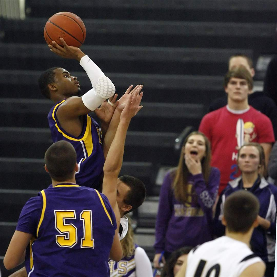Maumee-s-Dominique-King-throws-up-a-shot-against-Perrysburg