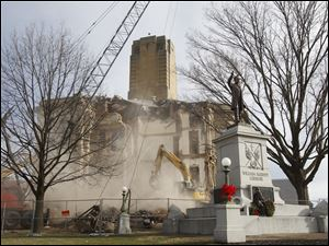 Dust and debris surround the courthouse as demolition continues.