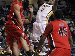 Ball State's Tyler Koch guards UT's Rian Pearson during 2nd half at UT's Savage Arena in Toledo, Ohio.