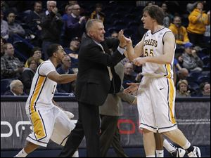 UT's Dominique, left, and head coach Tod Kowalczyk react to Richard Wonnell tying the game with a few minutes left in the 2nd half against Ball State at UT's Savage Arena in Toledo, Ohio.