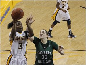 Rockets player Lecretia Smith is guarded by EMU's Olivia Fouty.