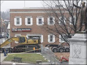 Another piece of demolition equipment arrives at the  courthouse.