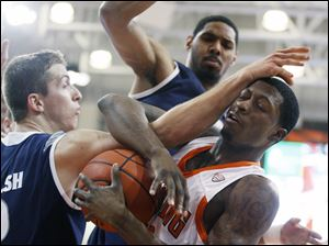 Falcons forward Torian Oglesby (32) battles Zips guard Brian Walsh (2) for a rebound.