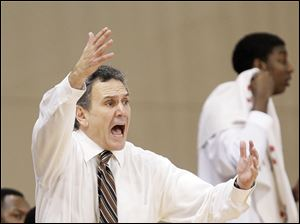 Akron head coach Keith Dambrot shouts instructions to his team.