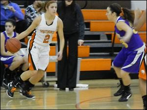 Southview Junior Lexi Lopez, 2, dominated on offense. Guarded by Maumee Junior Bailee Patterson, 33.
