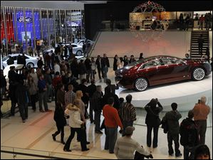 Car buffs get a glimpse of the Lincoln MKZ concept during the North American International Auto Show in Detroit, Mich.
