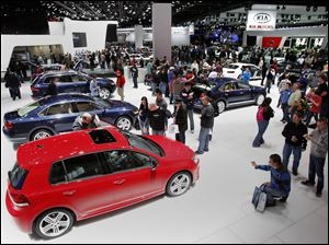 Fans check out vehicles at the North American International Auto Show in Detroit, Mich.