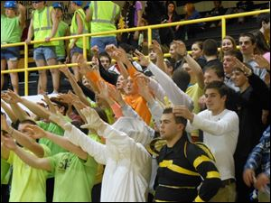 Northview fans cheer on the Wildcats, hoping to distract the Perrysburg Yellow Jackets, during a girls basketball matchup.