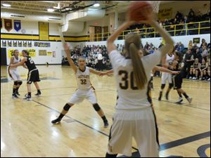 Lauren Yurjevic (32) signals for a pass from Northview teammate Miriam Justinger (30).