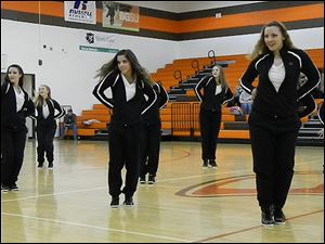 The Cougars dance team gets into rhythm.