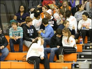 Sylvania students chat with each other during a break in the action.