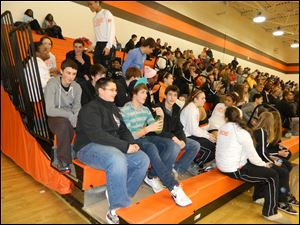 Southview students watch as the varsity girls basketball team takes on Maume.e