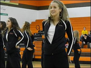 Sylvania Southview junior and dance team member Kassie Bishop smiles at the crowd during the team's routine.