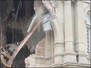 Pillars are seen being torn down as demolition continues.