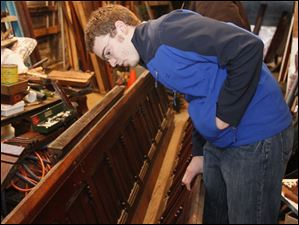Nick Borer, of Tiffin, inspects some of the wainscoting salvaged from the courthouse.