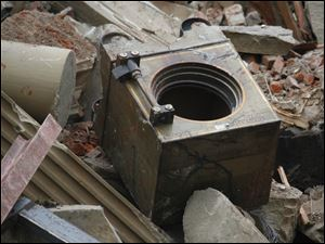 A safe sits in the rubble of the courthouse.