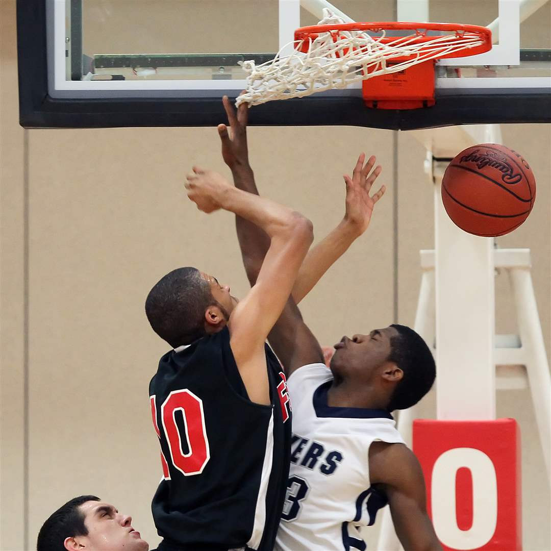 Lake-s-Marquise-Pitts-defends-against-Fostoria-s-Xavier-Ragin