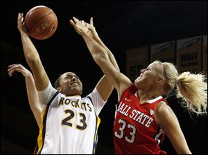 Toledo guard Inma Zanoguera (23) tries to keep the ball in hand against Ball State forward Katie Murphy (33).