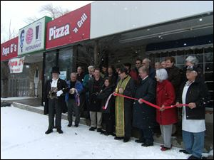 The ribbon cutting ceremony at Papa G's Pizza in the South Briar Shopping Center in Sylvania.