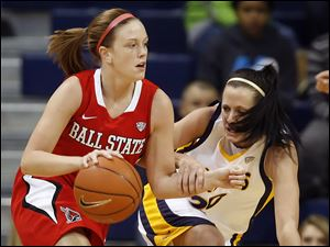 Rockets guard Stephanie Recker (20) keeps her eyes on the ball as Ball State guard Shelbie Justice (3) moves up the court.
