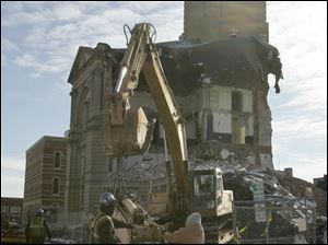 The demolition of the Seneca County Courthouse in Tiffin, Ohio continues.