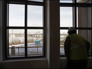 A member of the media takes in the view of the Maumee River from the Final Cut Steak and Seafood restaurant.