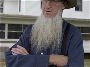 Amish sect leader Sam Mullet is jailed awaiting a March trial on hate crimes.
