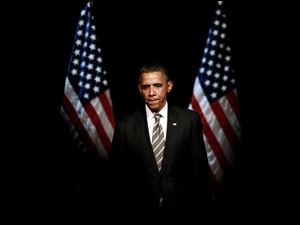 President Barack Obama pauses before shaking hands at a campaign event Thursday at the Apollo Theatre in the Harlem neighborhood of New York.