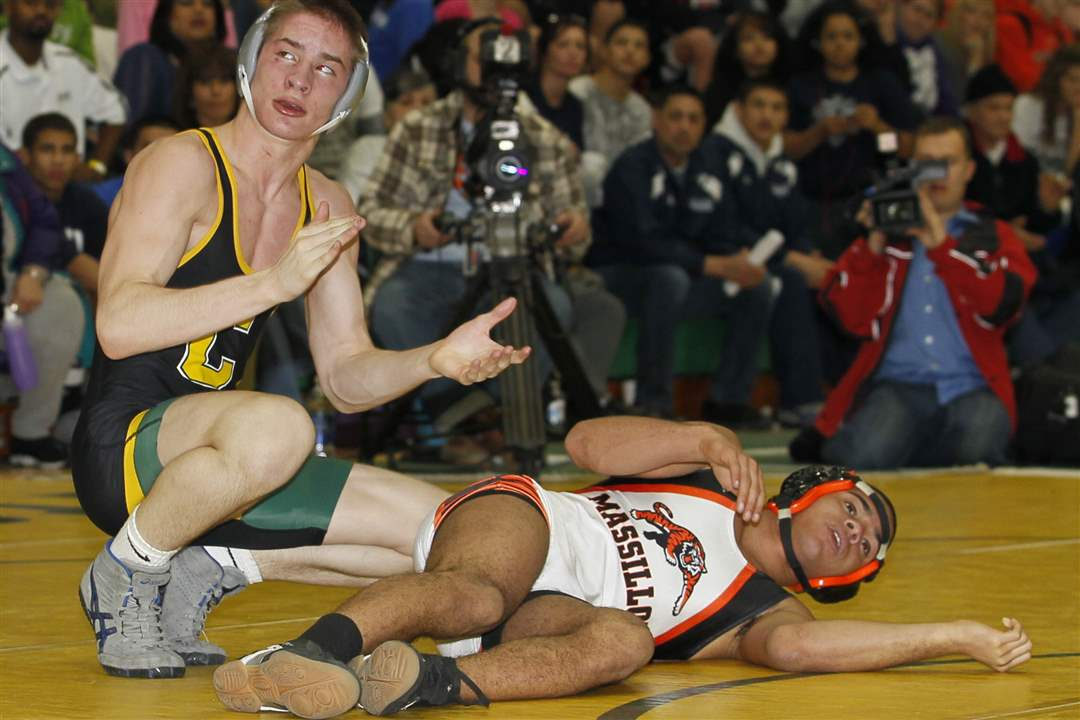 Oregon-Clay-wrestler-Mike-Screptock-left-celebrates-his-win-over-Ivan-McClay-of-Massillon-Washington